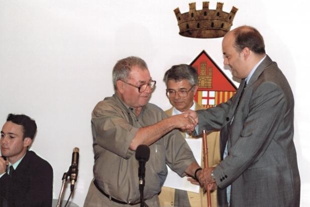 Rodés, al centre, en una de les investidures de Lluís Corominas, va presidir la taula d'edat